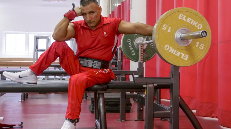 Peruvian powerlifter Niel Garcia Trelles poses on the benche staring at the camera