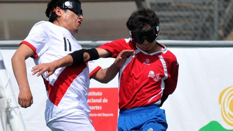 Peruvian and Chilean blind football players fight for the ball