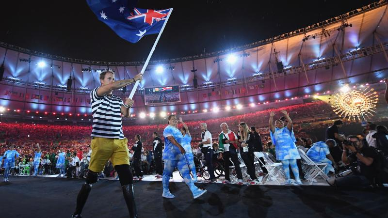 Australian Paralympian Curtis McGrath carries the country's flag at the Opening Ceremony of Rio 2016