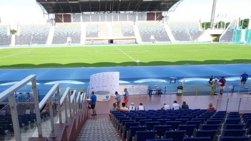 A stadium with a blue athletics track