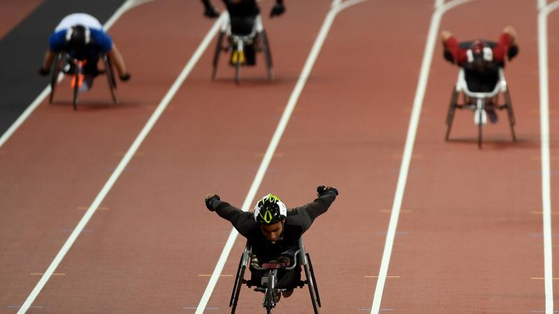 A wheelchair racer ahead of three competitors