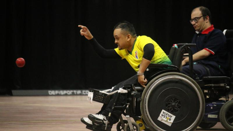 Brazilian boccia player in powerchair throws a ball