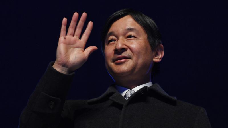 Emperor Naruhito of Japan waves to the crowd