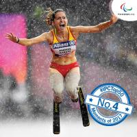 a female Para athlete dances in the rain
