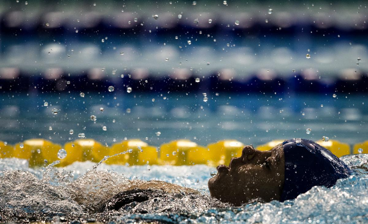 A woman swimming backstroke