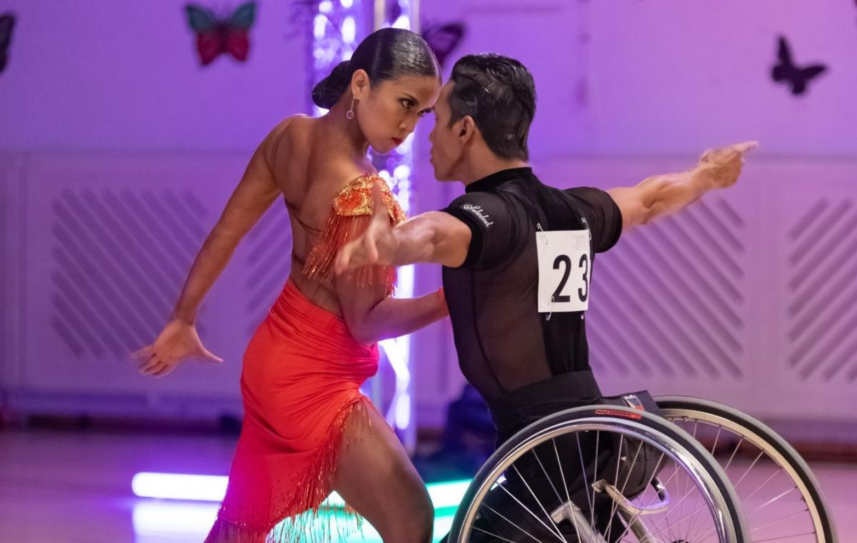 Female standing dancer dancers with male wheelchair dancer
