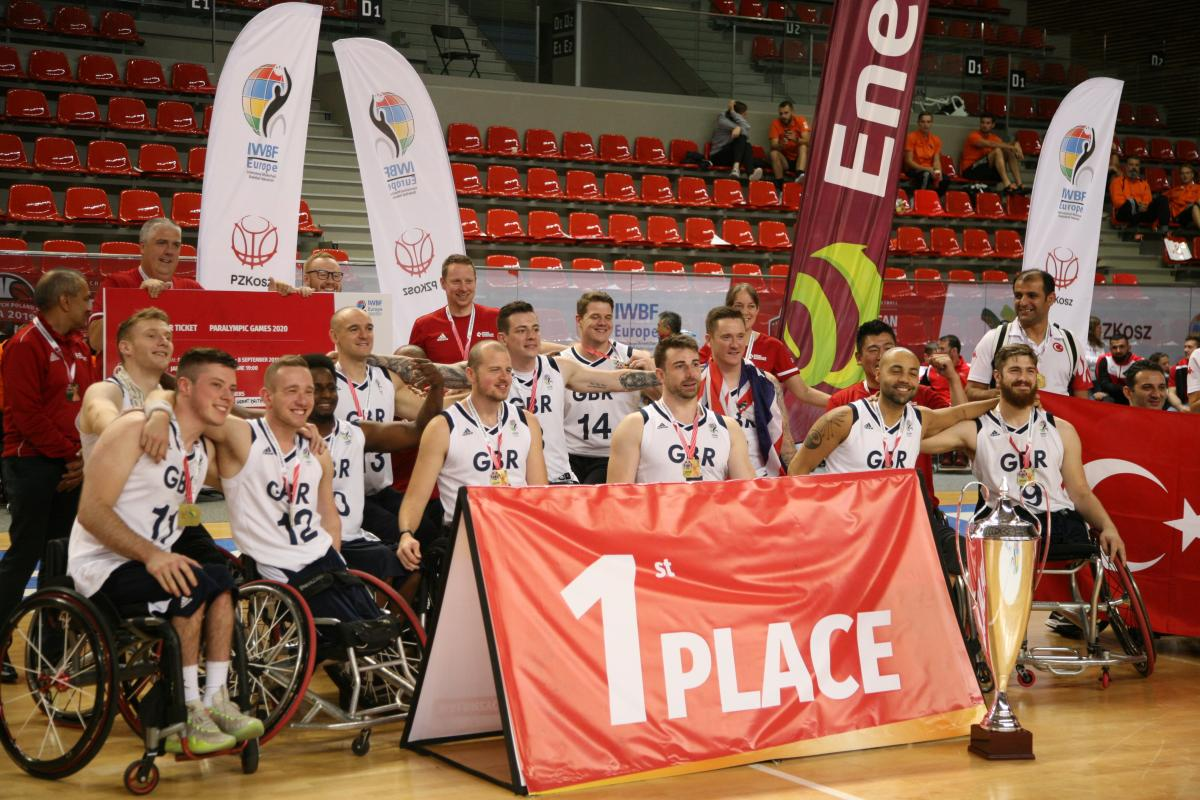 Group of wheelchair basketball players pose for photo