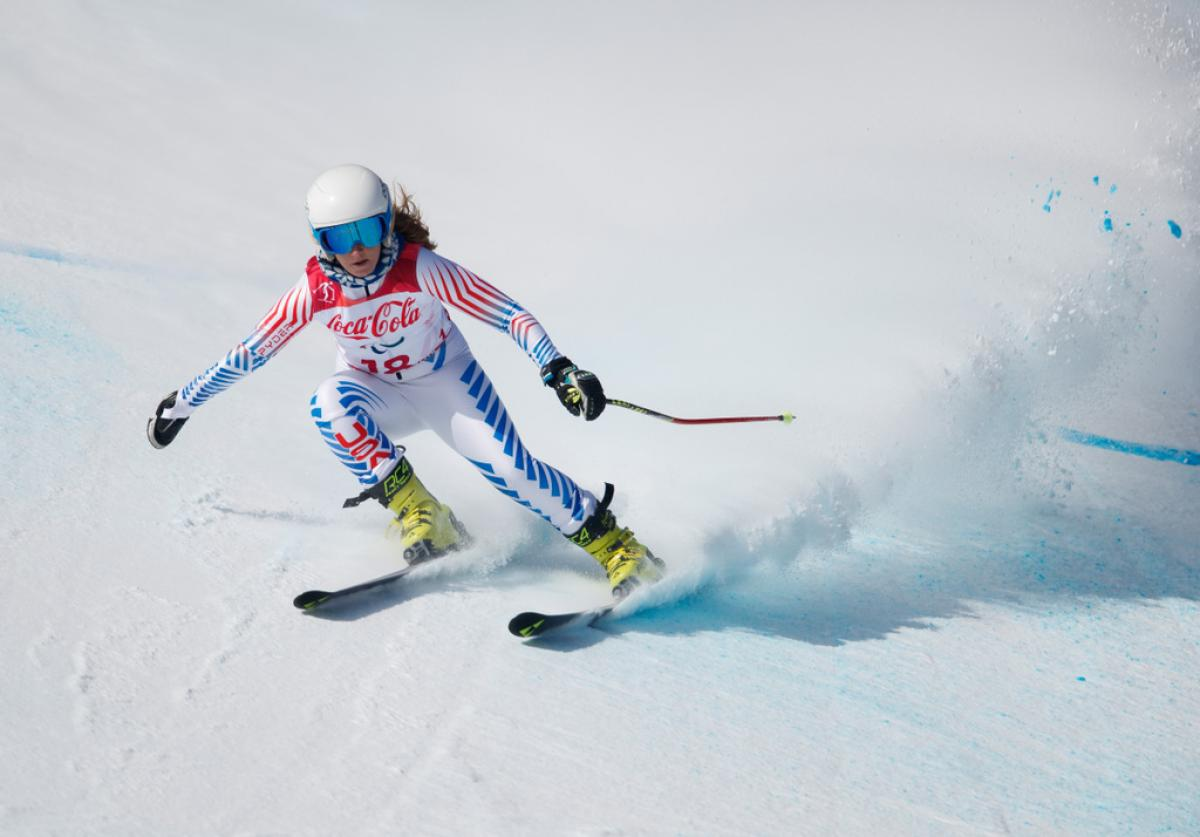 A female Para alpine skier competing on the snow