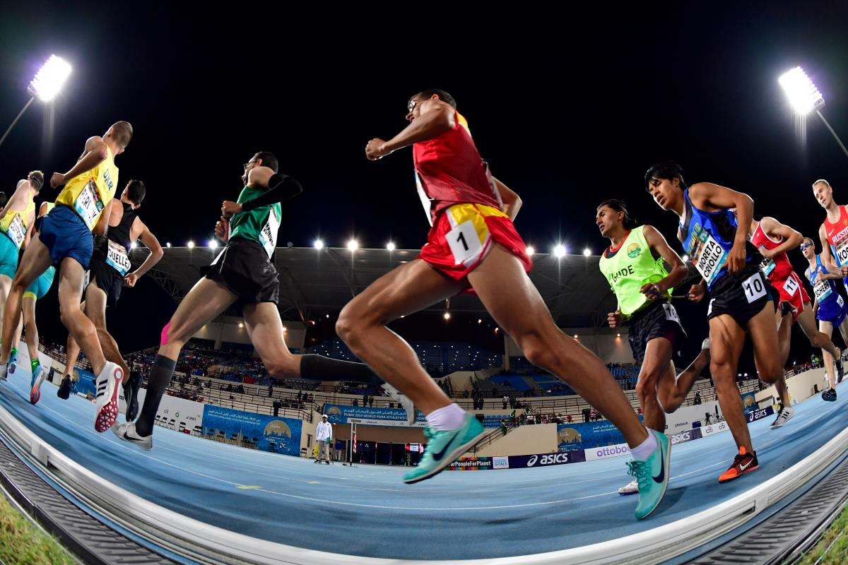 Athletes run through the track at the Dubai 2019 World Championships