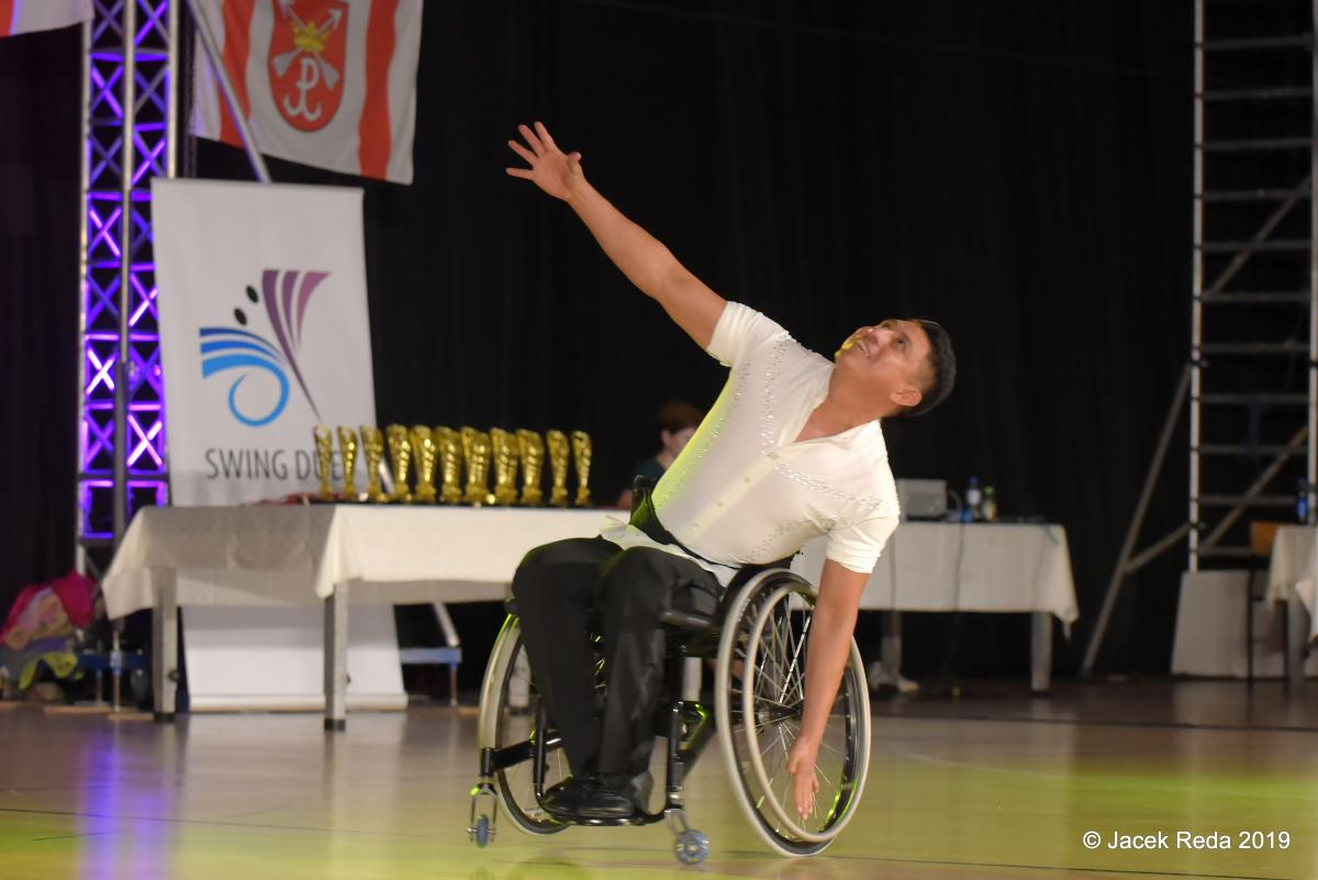 Mexican man in wheelchair dancing