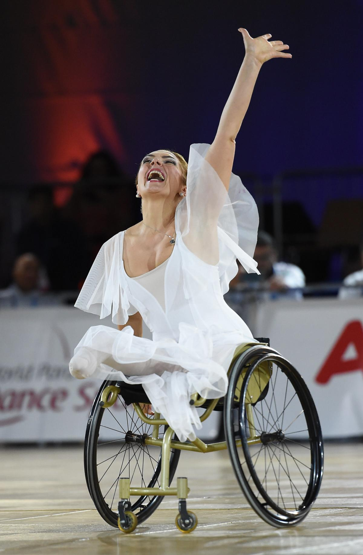 Woman in wheelchair performs expresses emotion in dance
