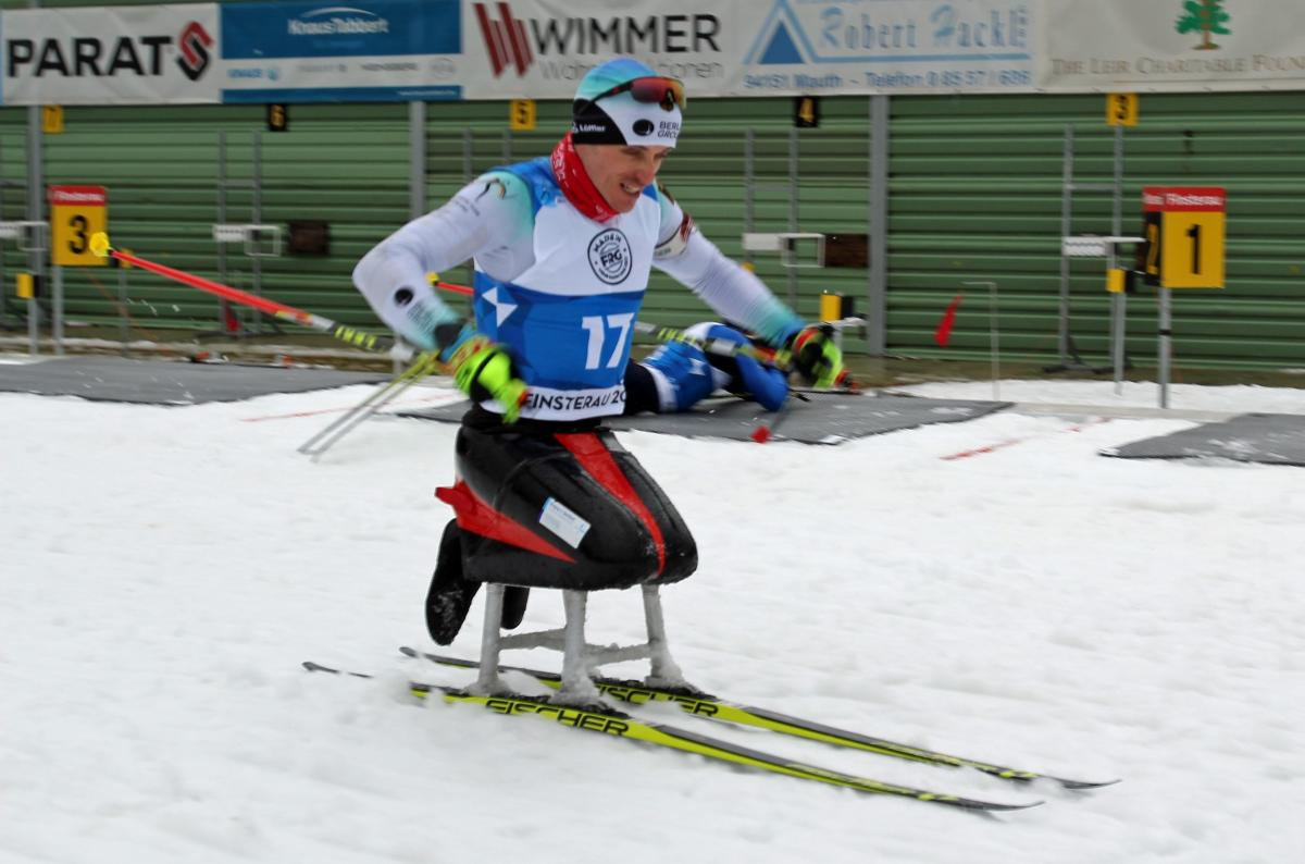 A male sit-skier competing on the snow