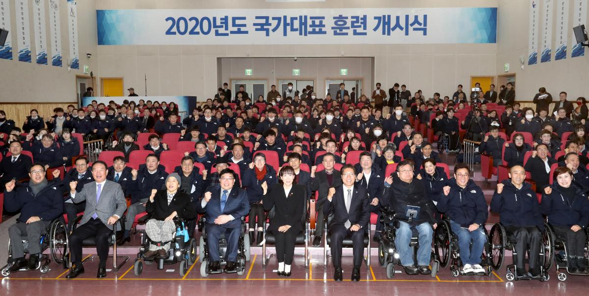 Group photo of athletes and staff at an initiation ceremony of a training centre