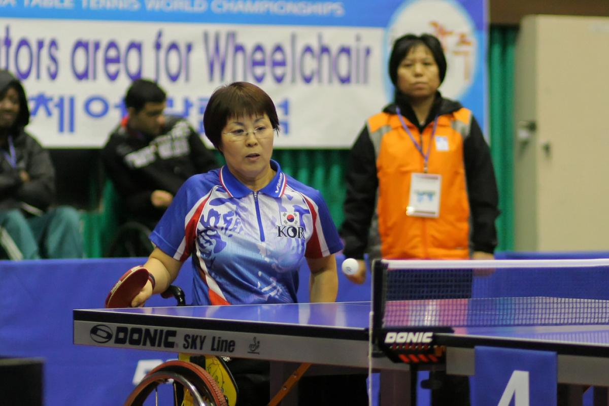 A Korean person is playing Table Tennis