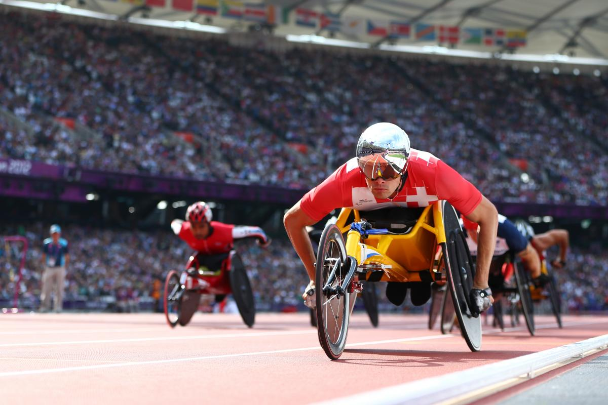 A picture of a man in a wheelchair on a track