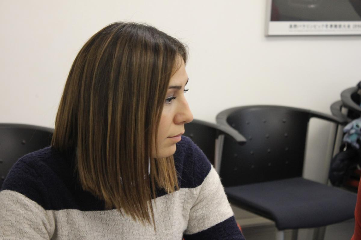 Gizem Girismen loioks to one side during a meeting