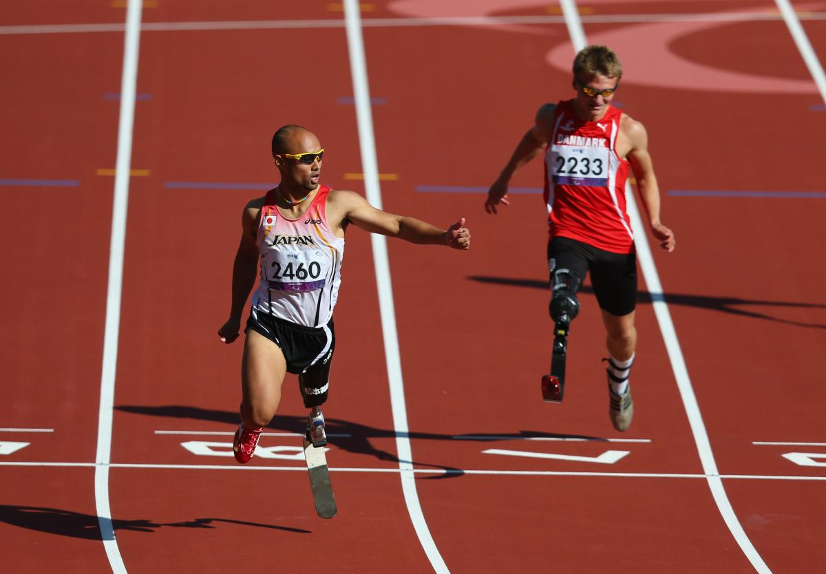 Atsushi Yamamoto of Japan and Daniel Jorgensen of Denmark compete in the men's 100m T42 heats at London 2012