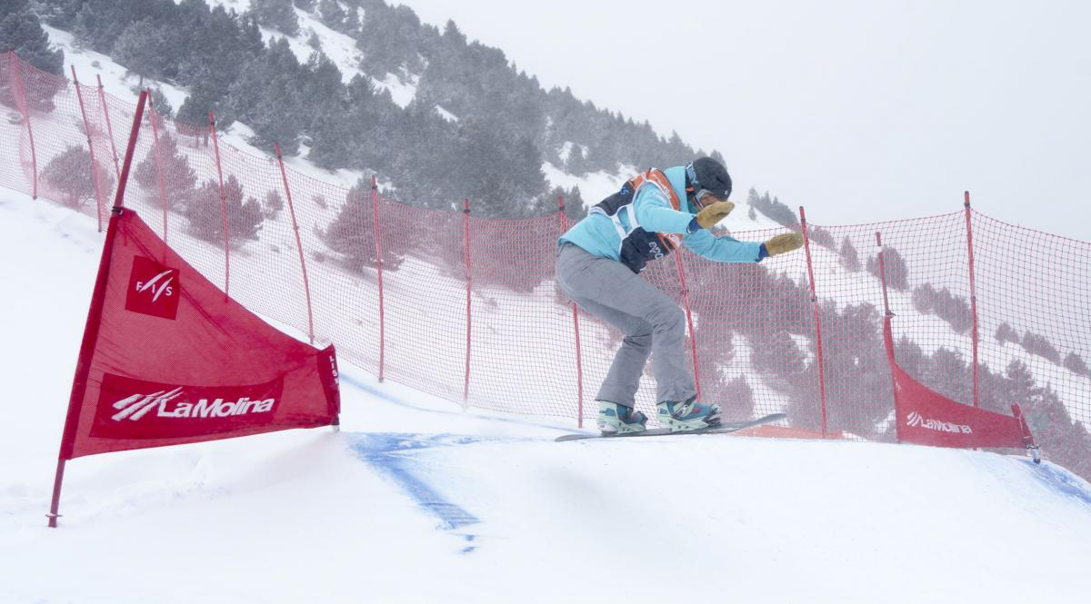 Women on snowboard on the slope