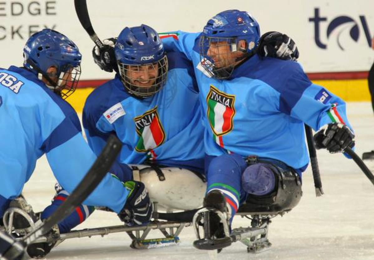Italy's players celebrate after winning their playoff game at Buffalo 2015.