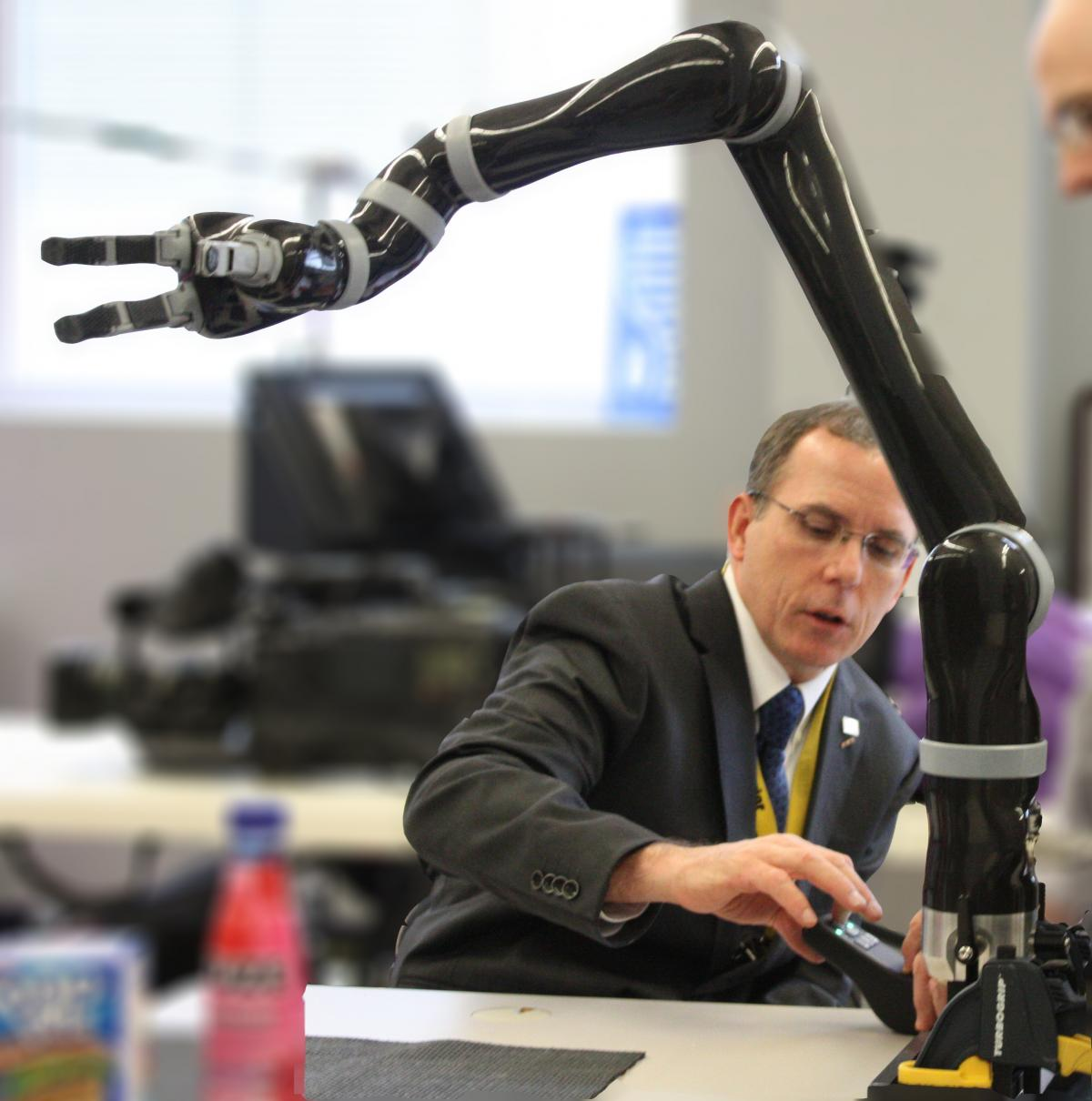 Man working with a robot arm