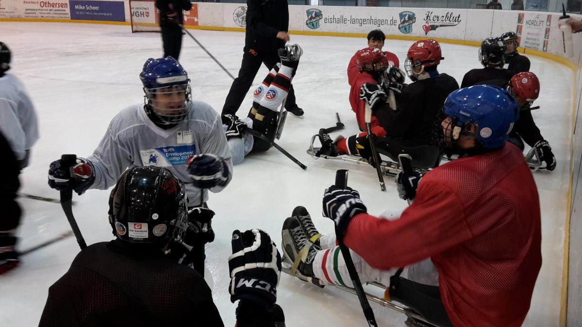 Ice sledge hockey players on the ice