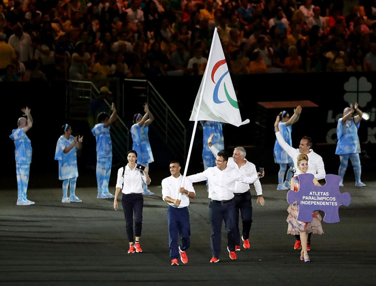 Flag bearer Ibrahim Al Hussein of Syria leads the Independent Paralympic Athletes team entering the stadium during the Opening Ceremony of the Rio 2016 Paralympic Games.