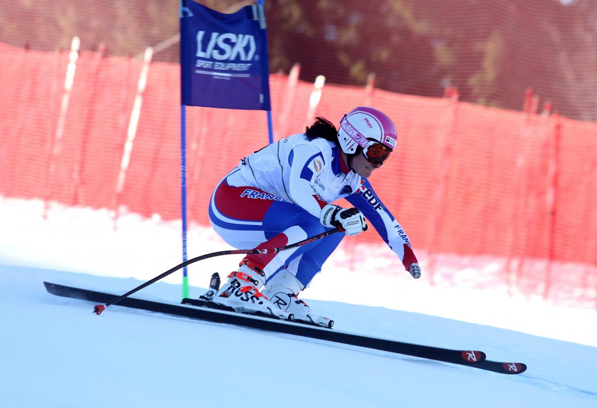 A skier competes in downhill