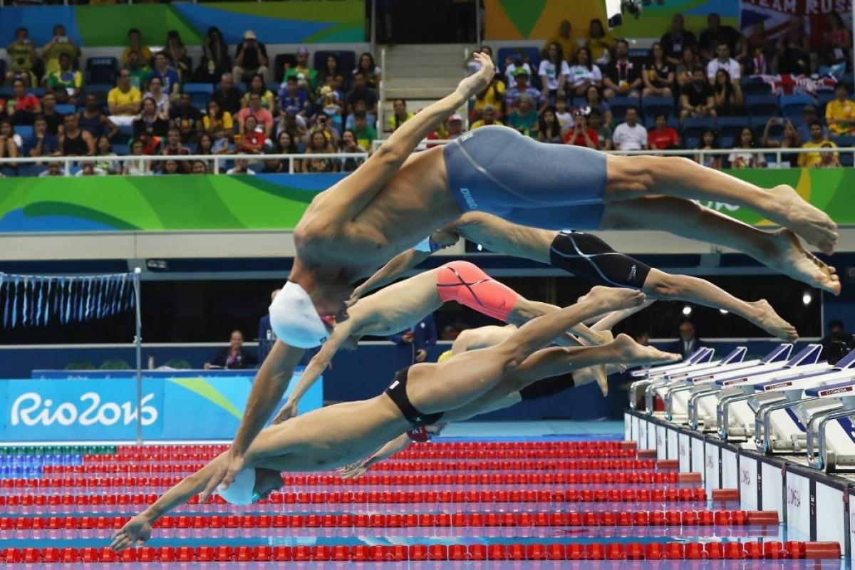 Swimmers dive to compete in the Men's 200m Individual Medley - SM8 Final at the Rio 2016 Paralympic Games.