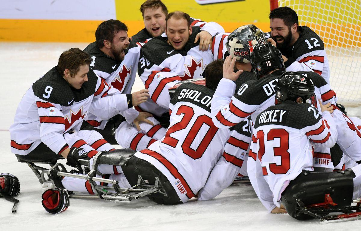 A group of Para ice hockey players celebrating.