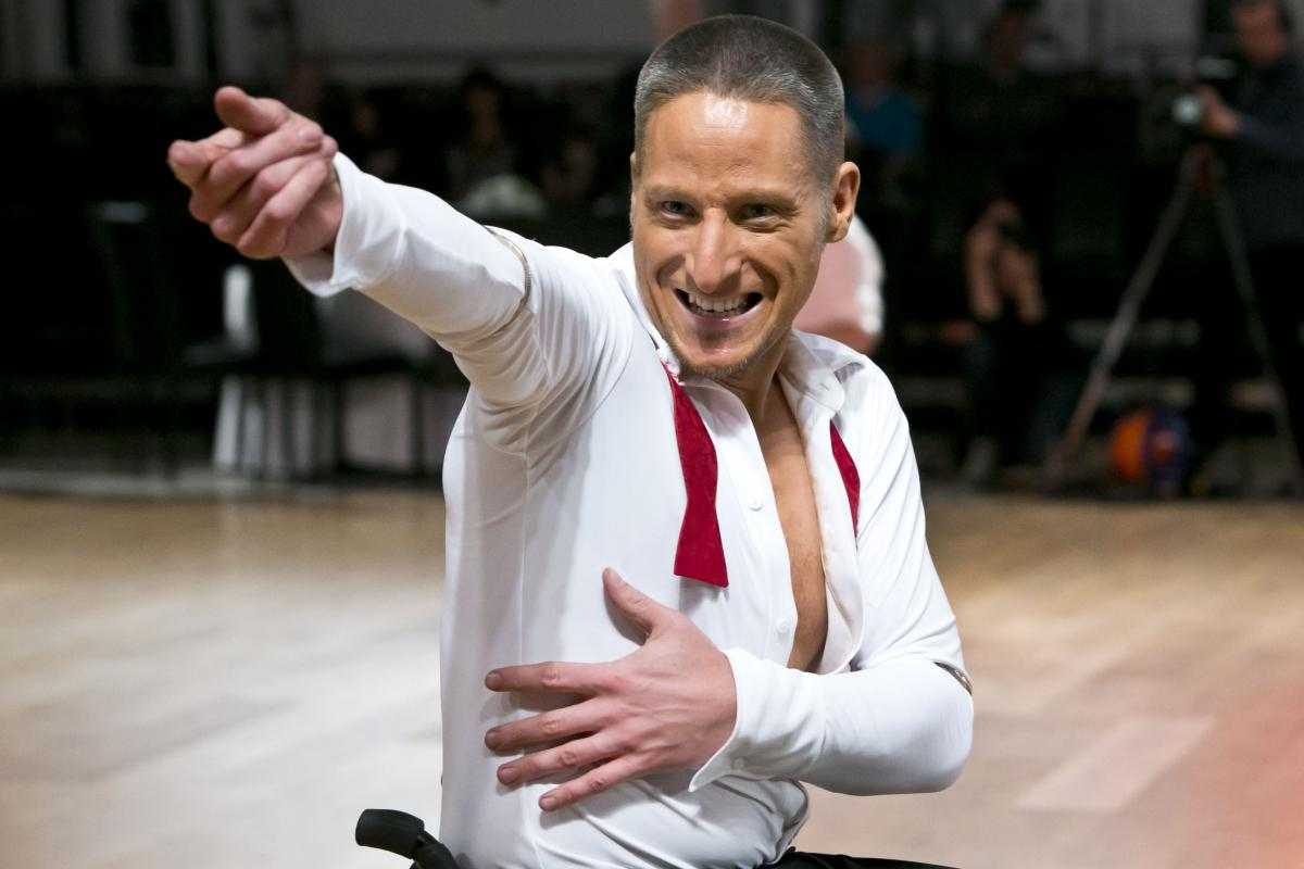 male wheelchair dancer poses for camera