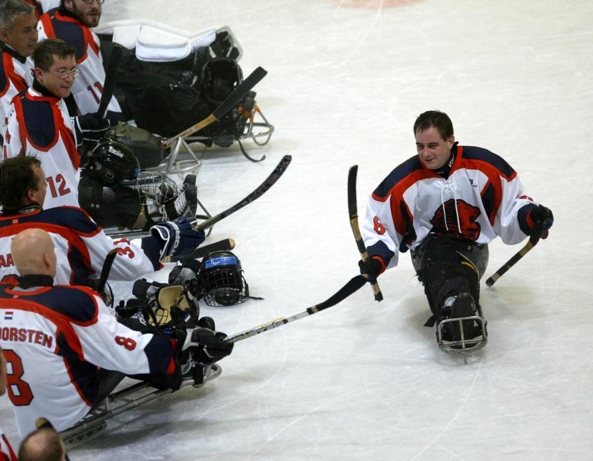 para ice hockey players on the ice