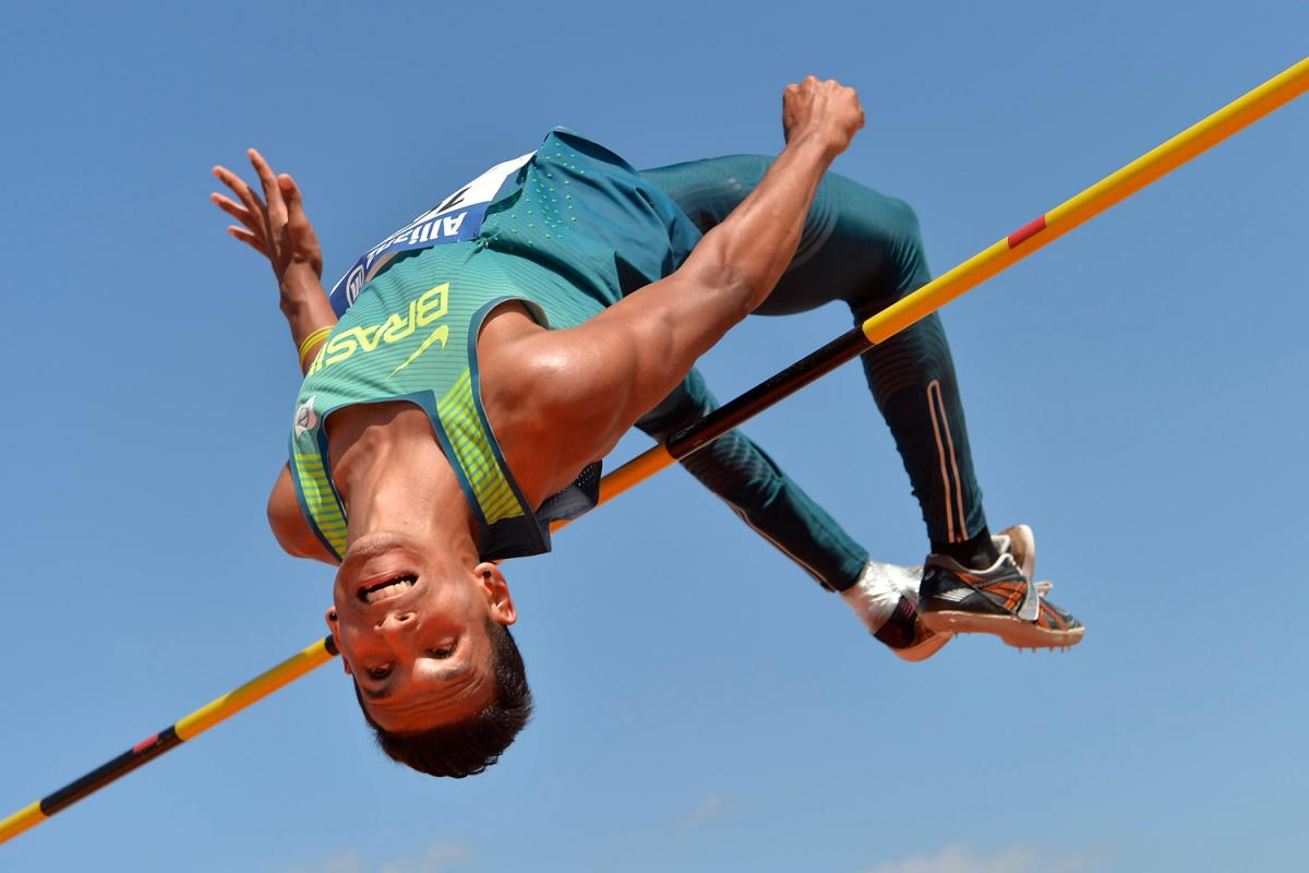 Brazilian athlete clears a bar in the high jump