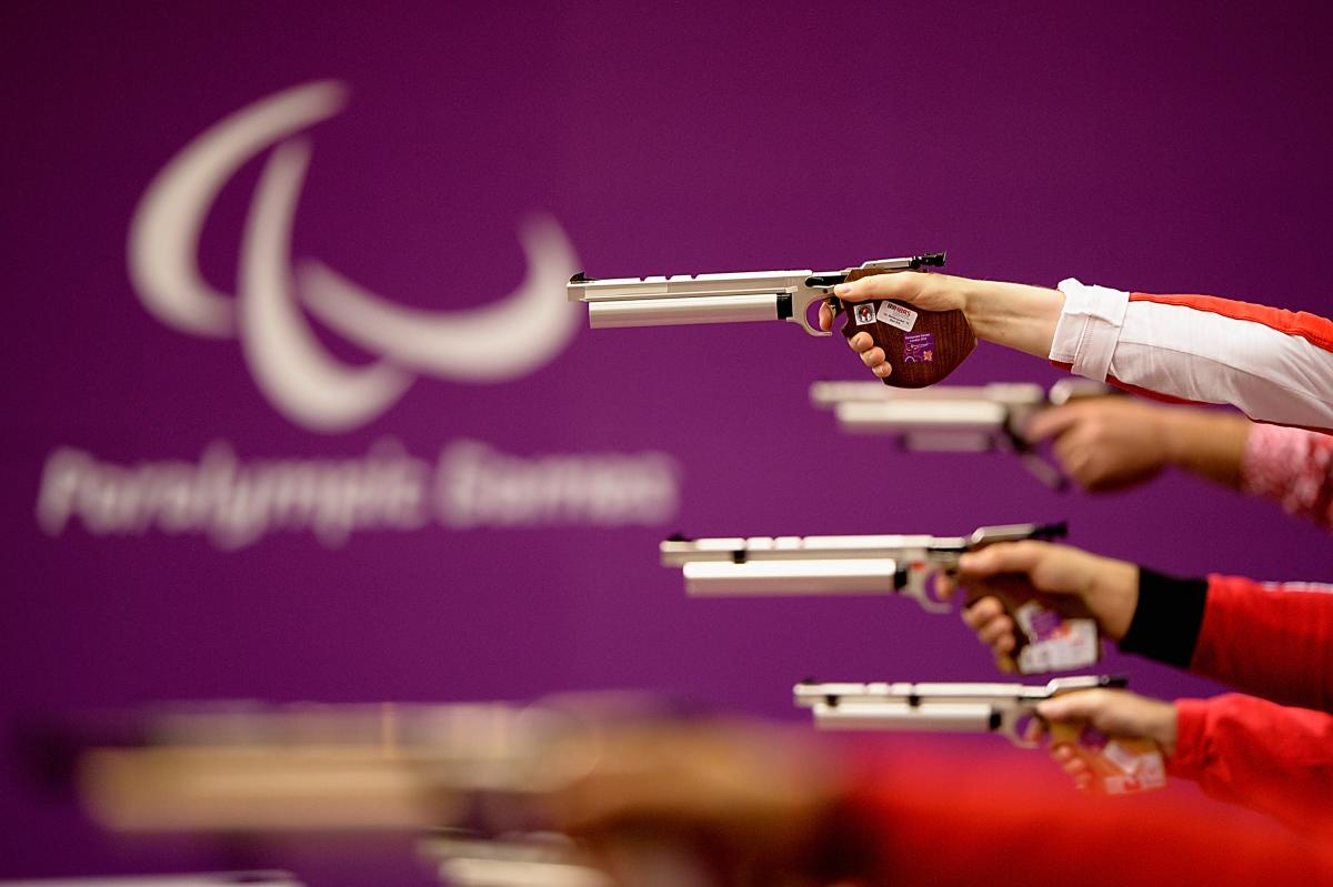 View down the line of pistol shooters in action