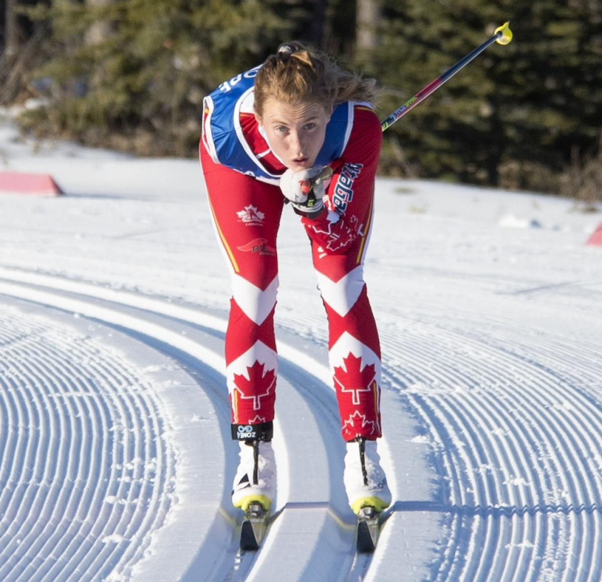 a female Para Nordic skier on the snow