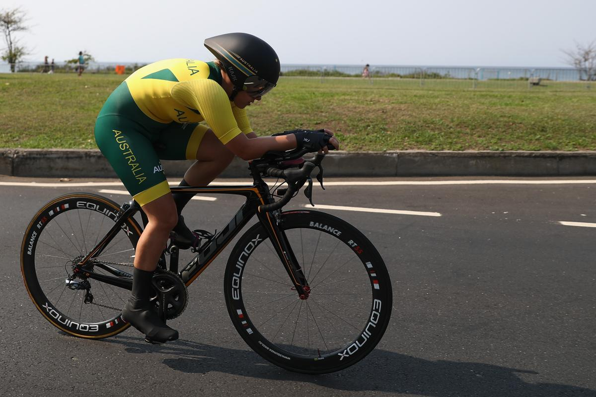 a female Para cyclist on the road
