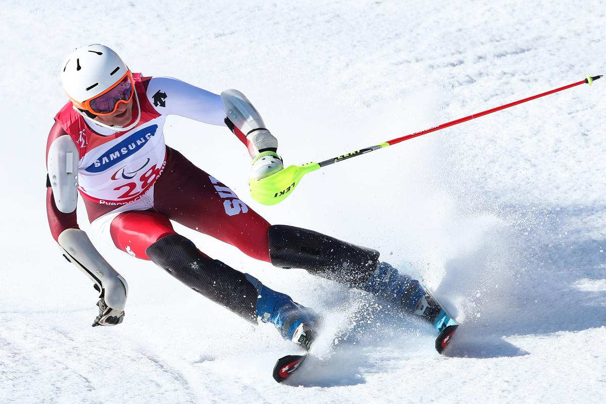 a male Para alpine skier in action