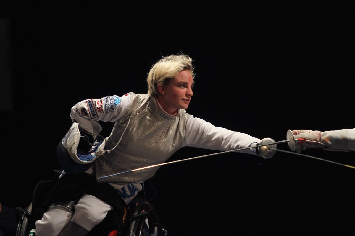 a female wheelchair fencer in action