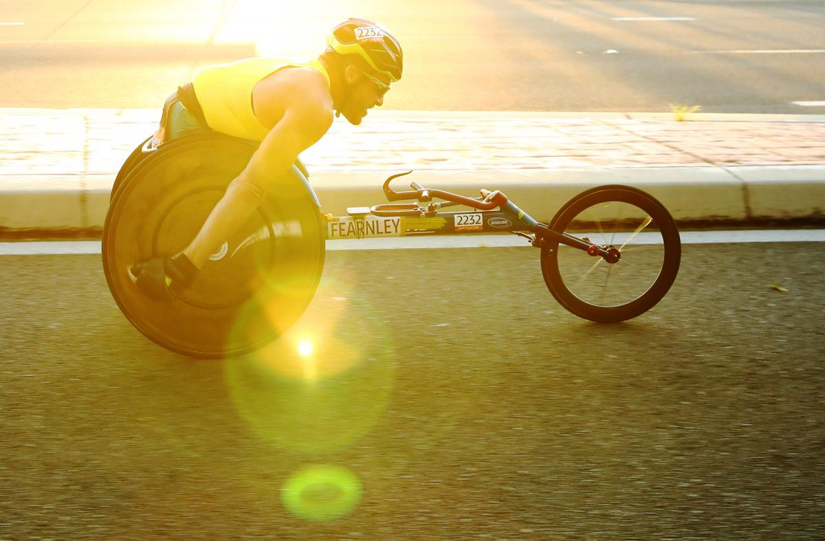 Athlete on wheelchair taking part in race