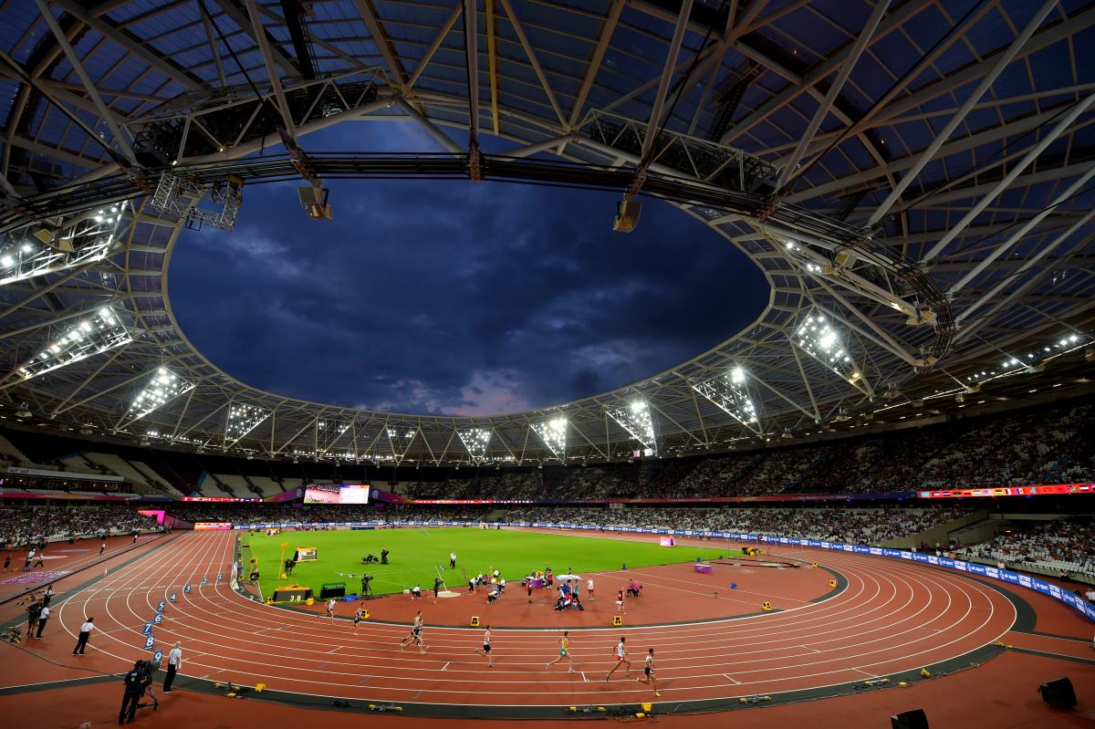 a wide shot of an athletics stadium at night