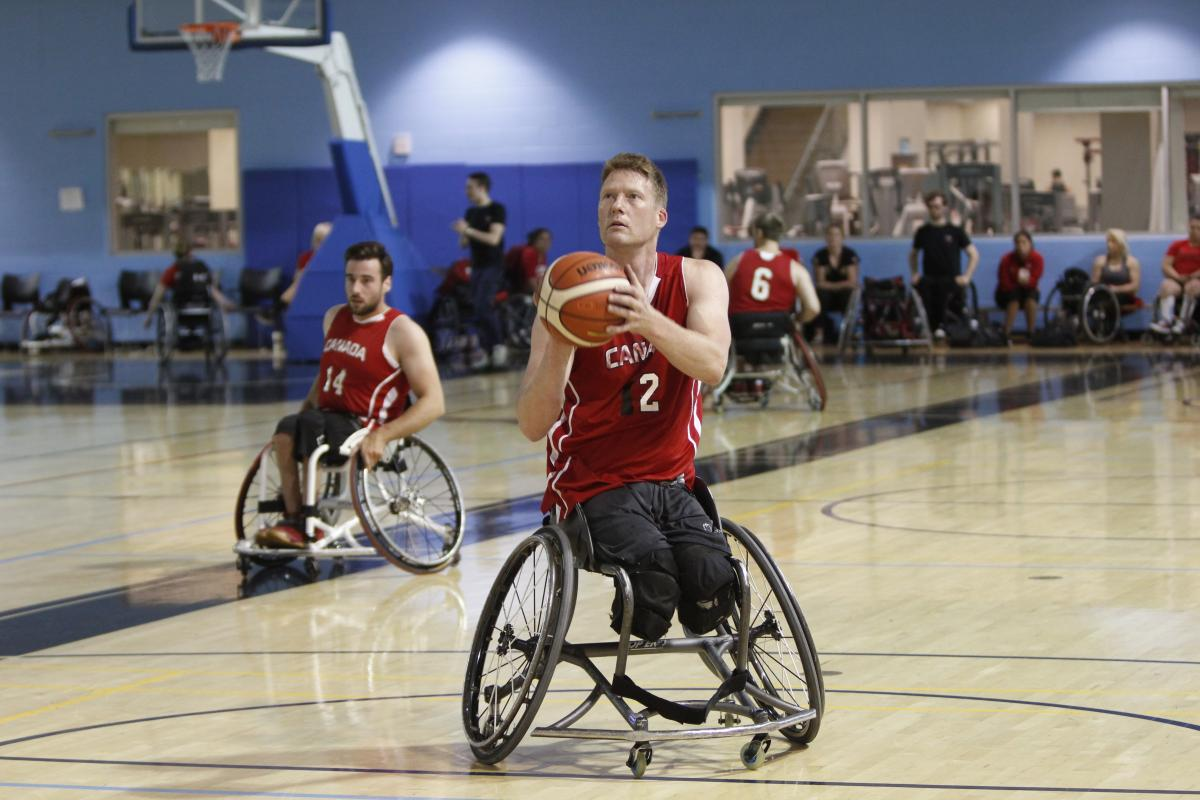 a male wheelchair basketballer goes to take a shot