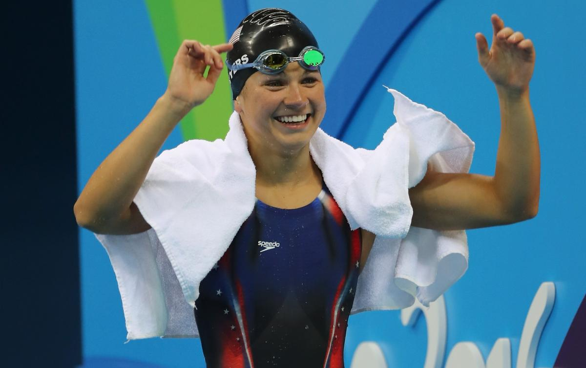 female Para swimmer Rebecca Meyers celebrates after getting out of the pool