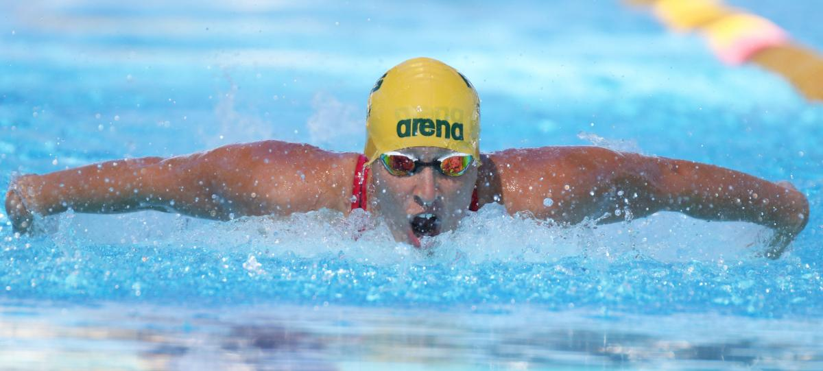 male Para swimmer Taylor Corry doing the butterfly stroke