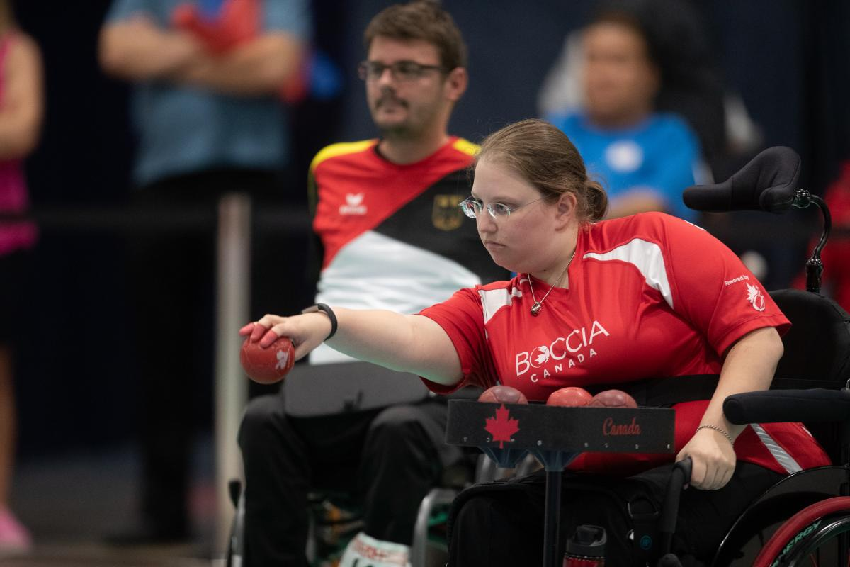 female boccia player Alison Levine takes a shot