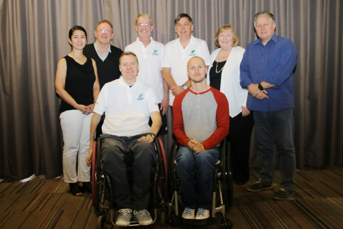 a group of people smiling including IWRF director Richard Allcroft