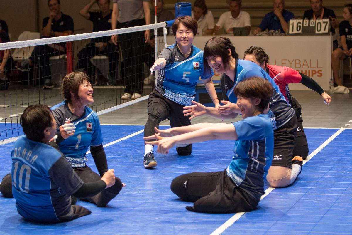 female Japanese sitting volleyball players play the ball