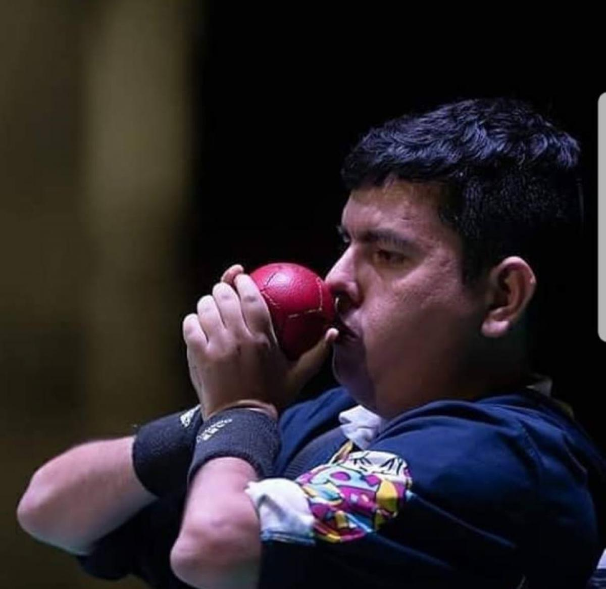 male boccia player Euclides Grisales prepares to throw the ball
