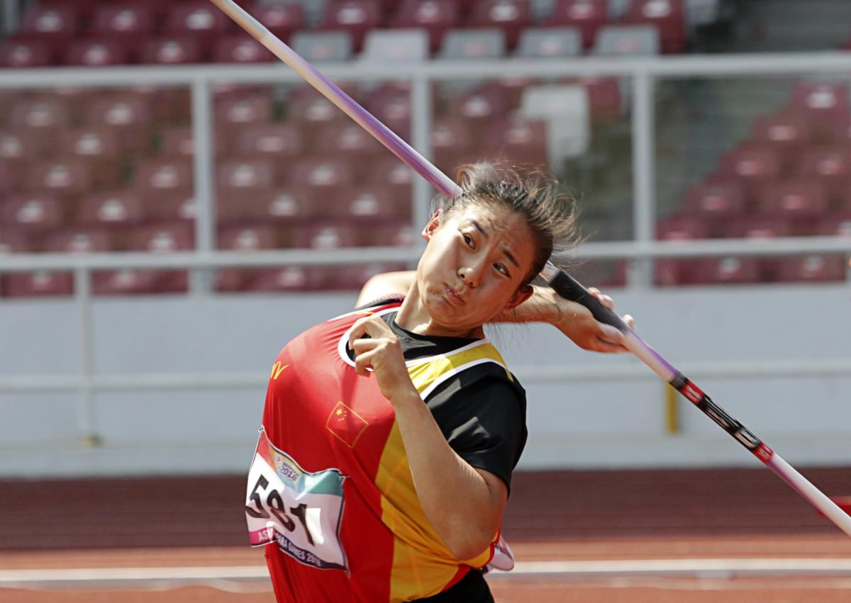 female Para athlete Zhao Yuping throws a javelin