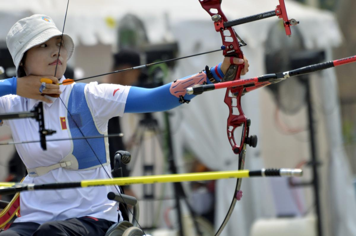 female Para archer Wu Chunyan draws back her bow to shoot an arrow