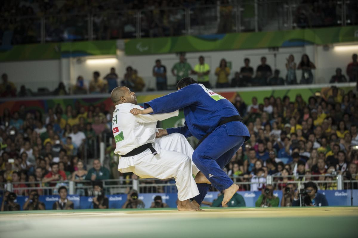 two judoka fighting on the mat