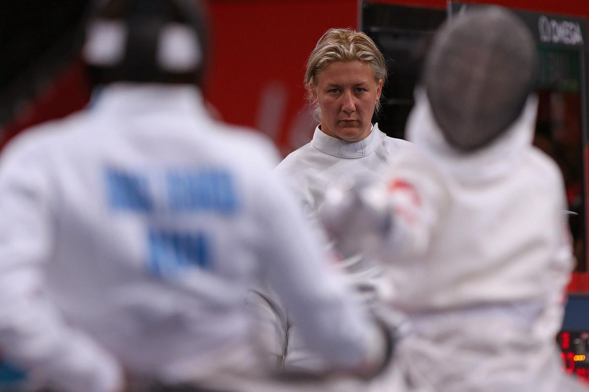 female wheelchair fencer Zsuzsanna Krajnyak with her guard off on the piste